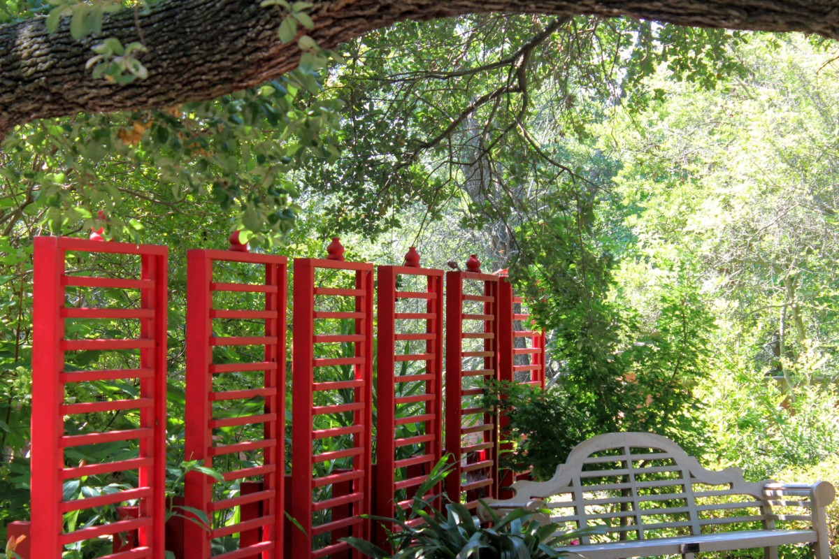 Red gated pop of colour in beauty of Chandor Gardens (Asian motif) - pocket guide to Weatherford TX