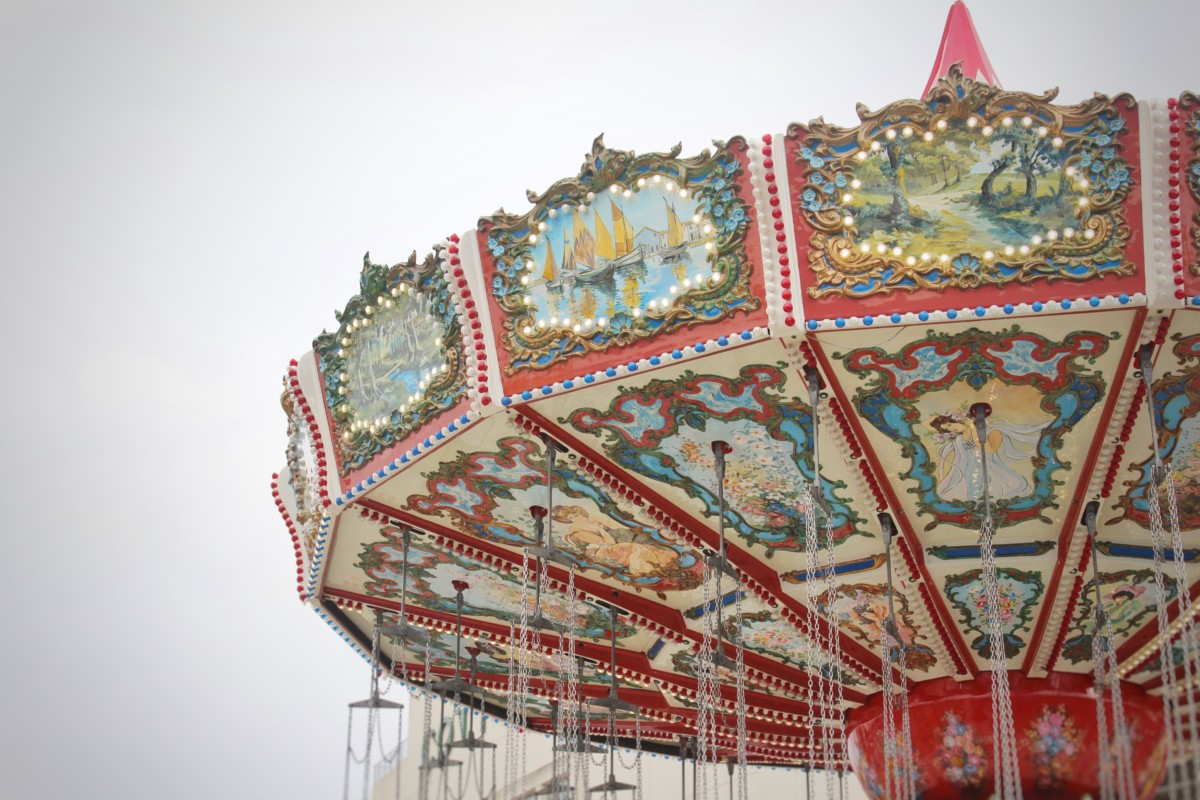 State Fair of Texas: Best Foods in the State Fair of Texas by the Midway Rides - picture of a red carnival swing carousel ride