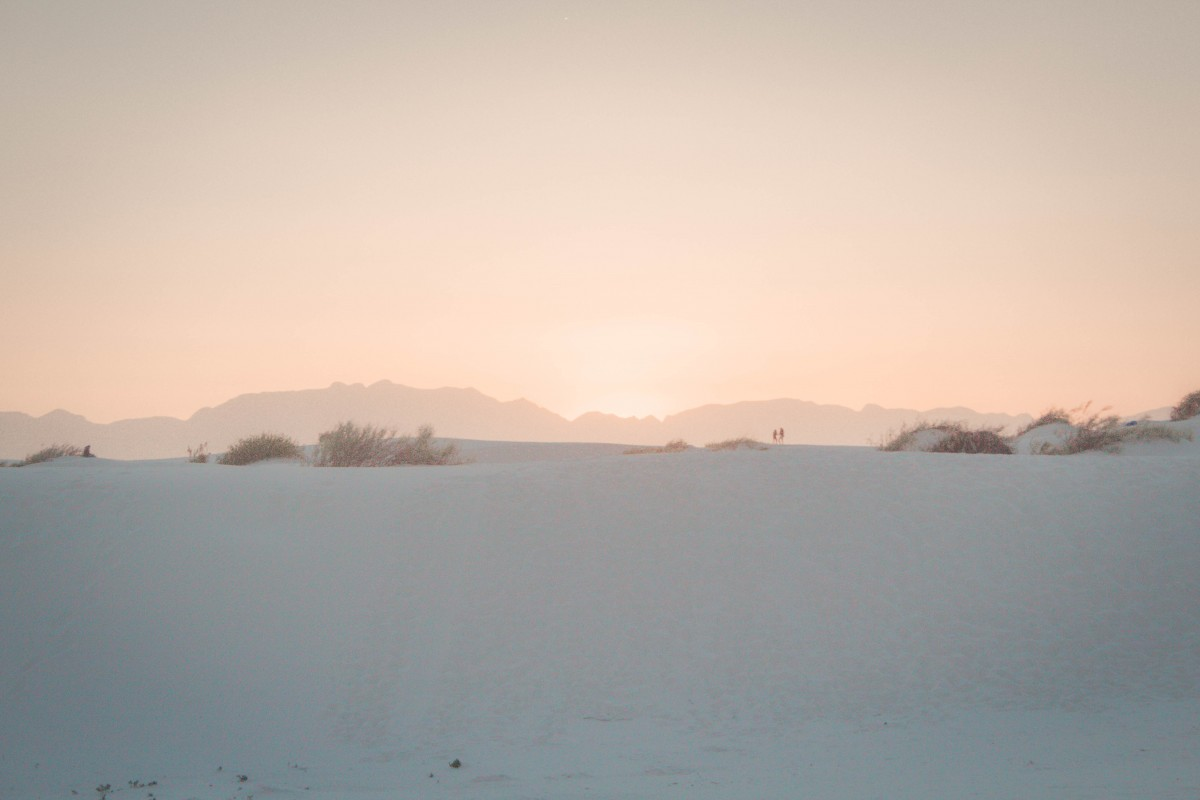 a gorgeous soft orange sunset seen while visiting White Sands