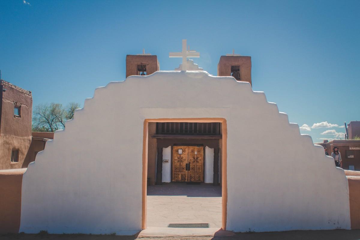 St.Jerome Church in Taos Pueblo, a unique mix of white and adobe that embodies Taos Pueblo's complex religion.
