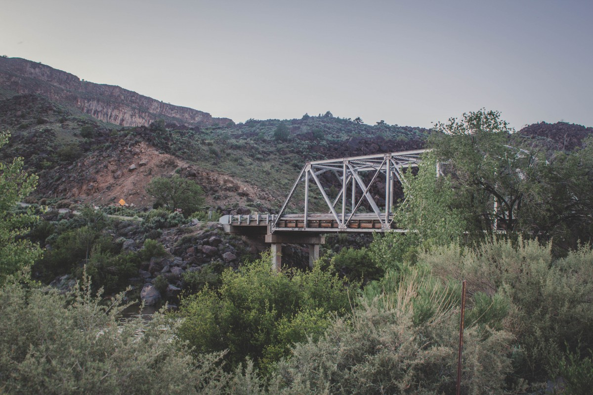View from Taos Junction Campground (a bridge, strip of a road, and lots of trees)
