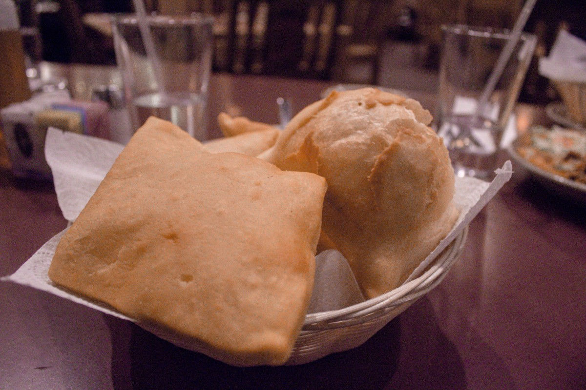 Sopapillas in a basket of different shapes and sizes. Sopapillas are traditional New Mexican foods.