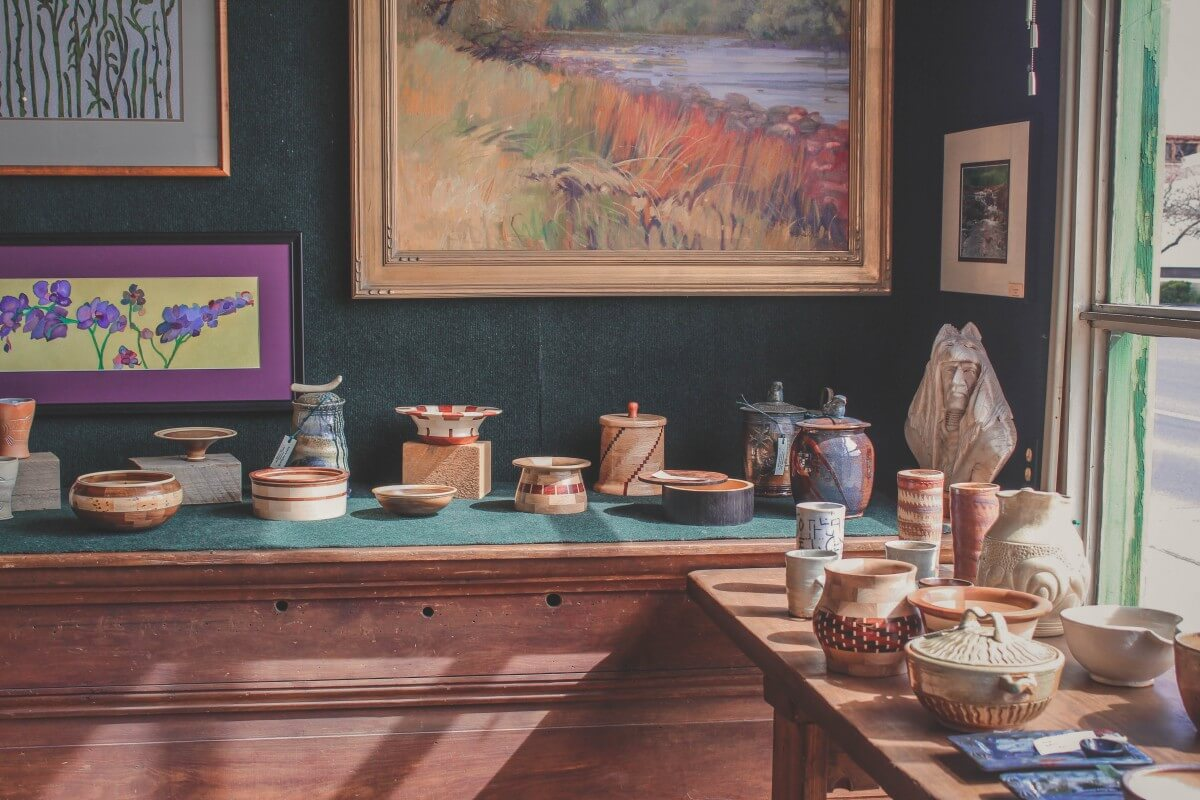 Pottery in Artifacts Gallery lined along the shelves.