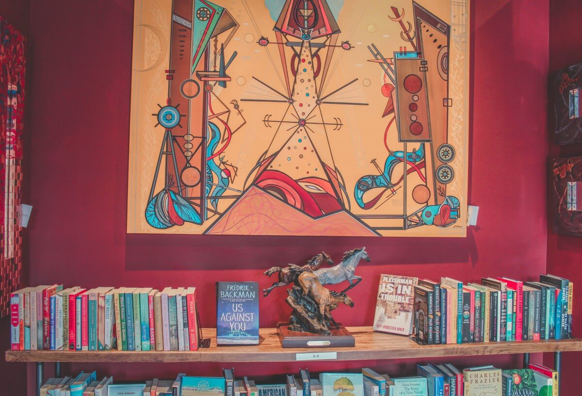 Bookshelf popping out against a vibrantly colored wall in Anticus.