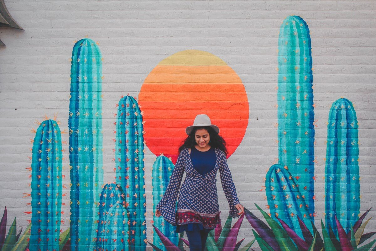 Standing in front of the It's That Hot in Scottsdale Instagrammable Wall