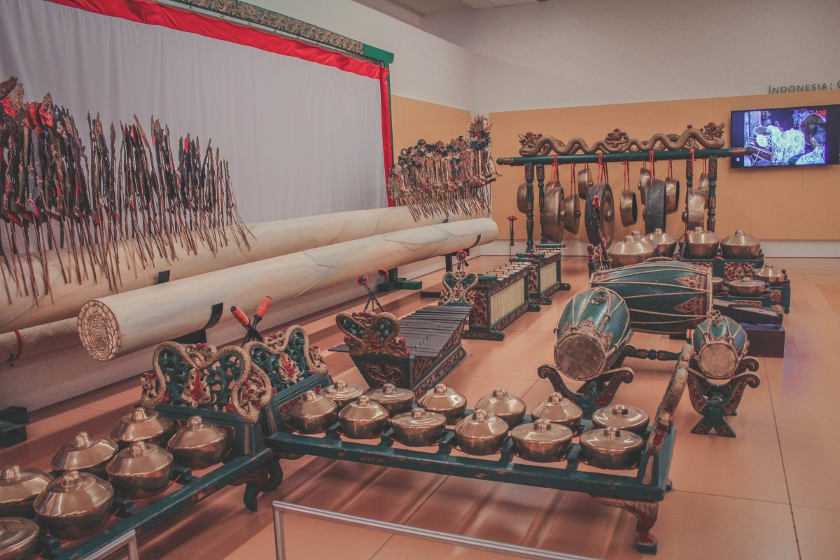 Inside MIM. A row of musical instruments all laid out in a beautiful display