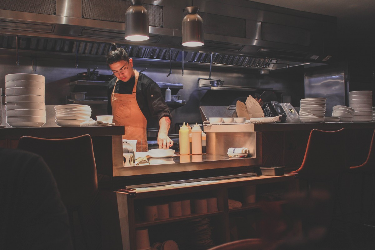 Man cooking dinner at Clever Koi