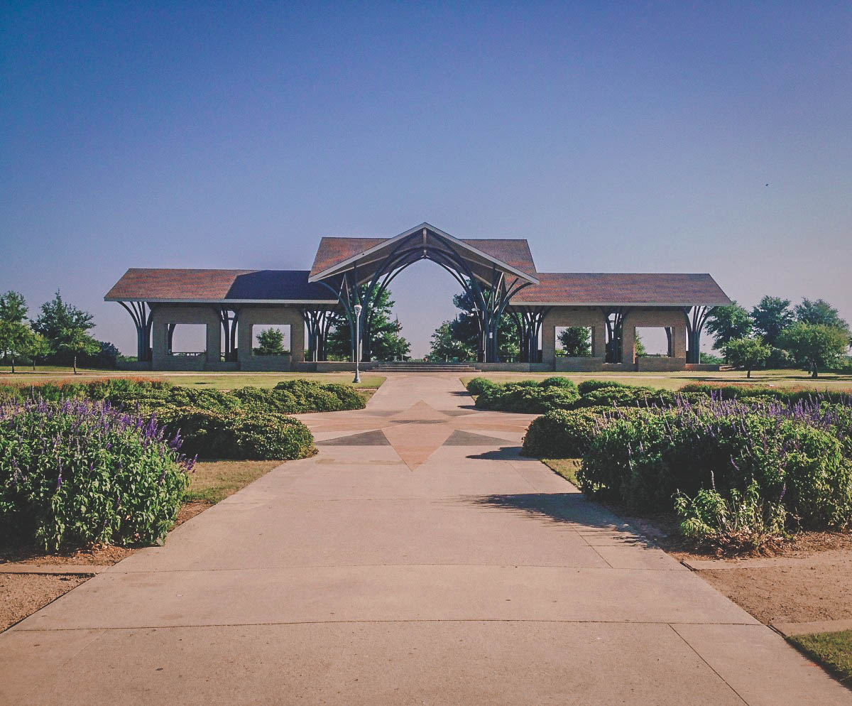wide pathway (purple flowers along each side) leading up to a gazebo at Frisco Commons