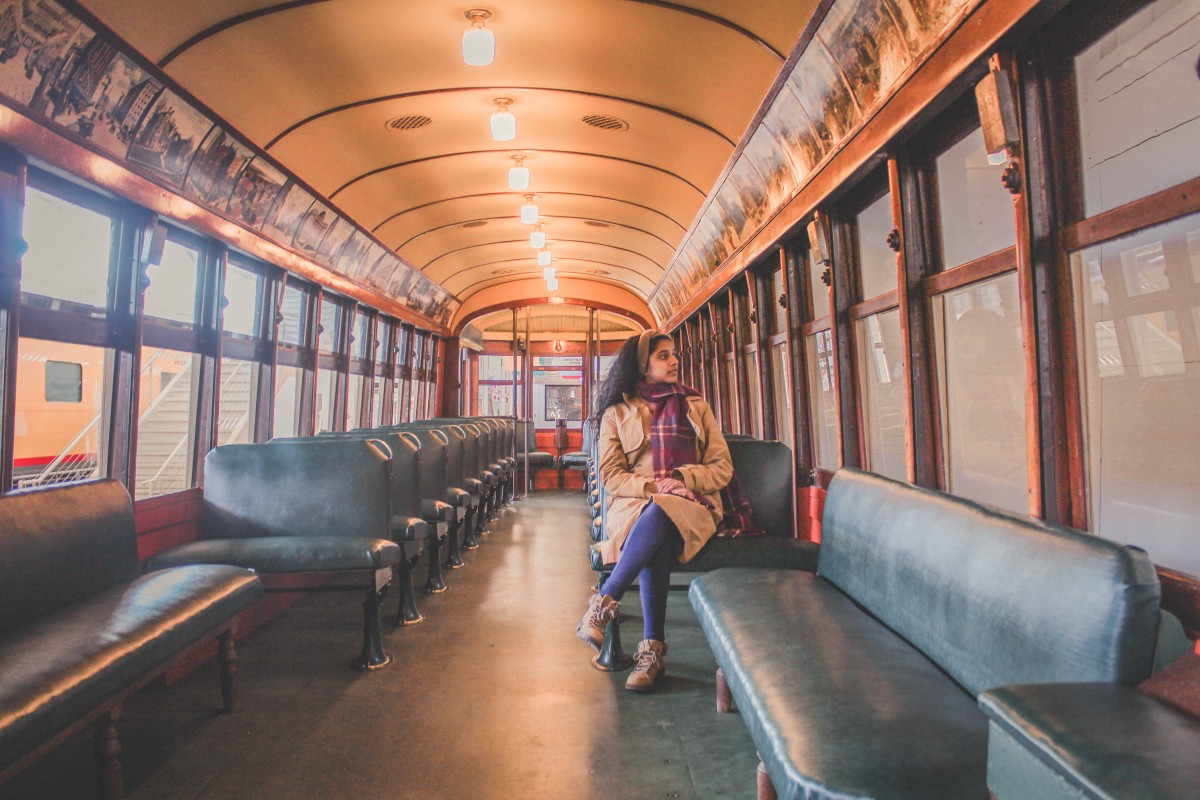 Anshula sitting in an old Union Station railcar