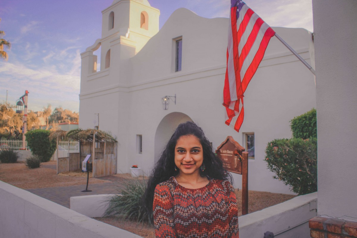 standing in front of the Old Adobe Mission