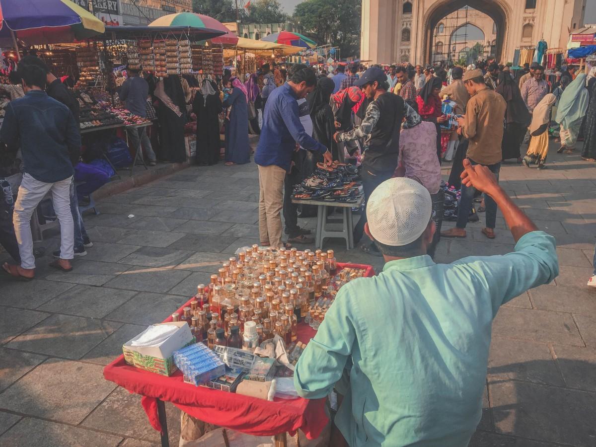 Merchant at Charminar Market selling ittar