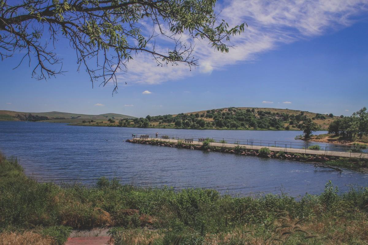 Large Lake With Couple Fishing