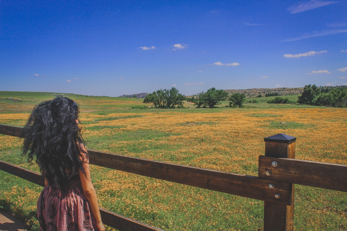 Girl looking at a prairie dog town