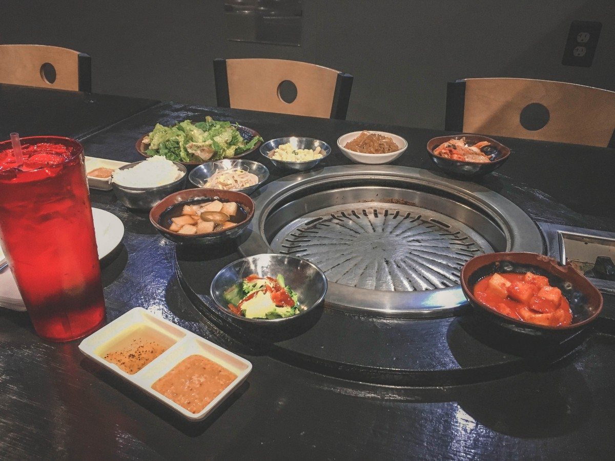 a table at Yoon's Korean BBQ, one of the cheapest AYCE restaurants in Carrollton, Texas