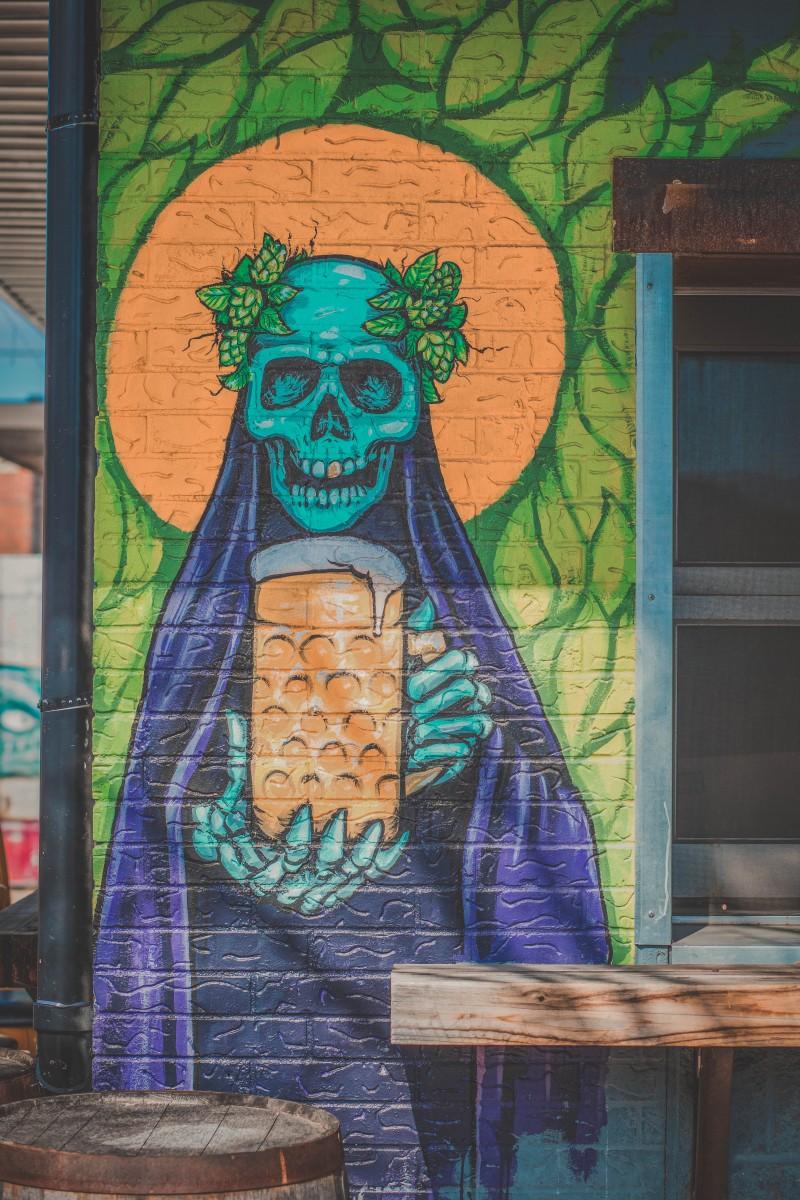 Street art outside a bar in Deep Ellum