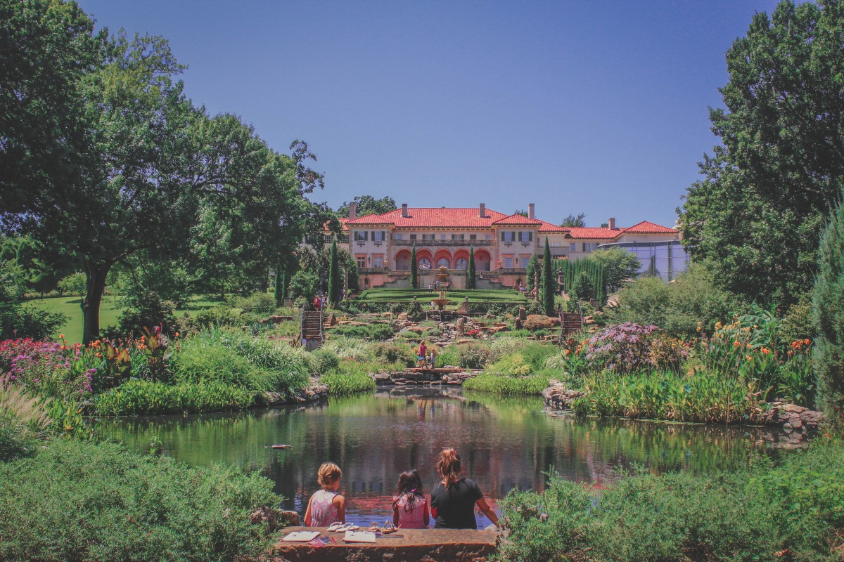 photo of the gardens at the Philbrook Museum, lake and terraced gardens facing the house