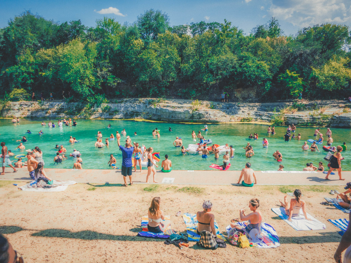 Best things to do in Austin: people swimming in Barton Springs Pool