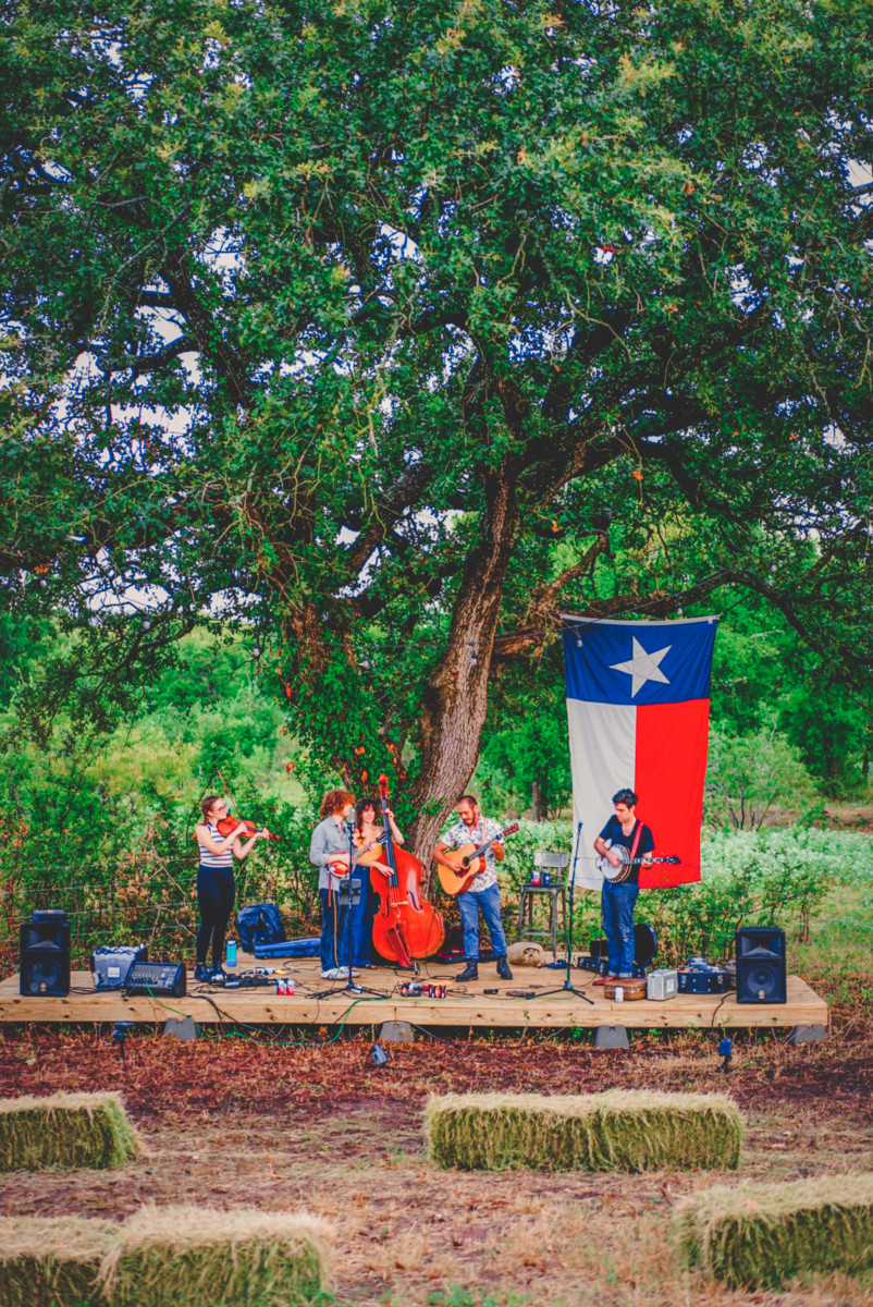 a group of people playing string instruments in Austin, Texas