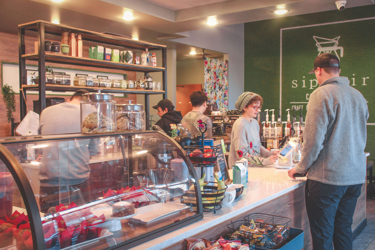 Sip Stir Coffee House cafe serving lattes