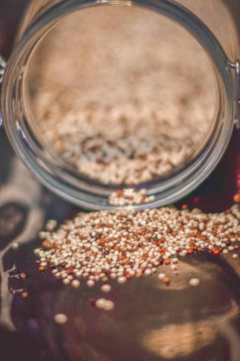 quinoa spilling out a jar, quinoa milk featured